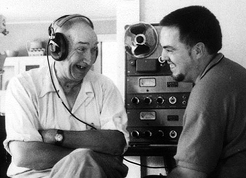 Alan Lomax, ethnomusicologist, on the right