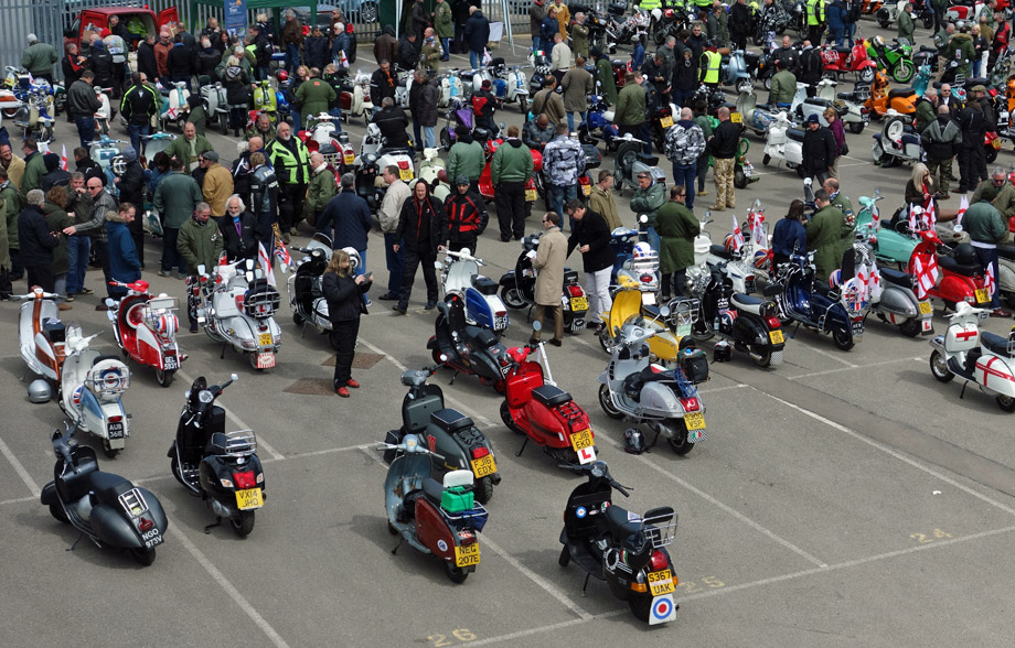 Scooterists gather in the carpark at Cambridge United FC.